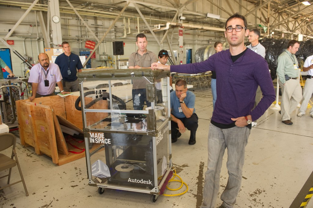Made in Space CTO Jason Dunn displays a 3D Printing Test Experiment.